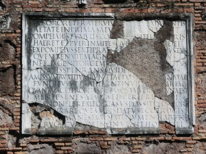 Lettering on one of the tombs in the Via Appia, Rome