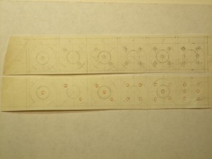 Strips of slunk vellum with pencil lines