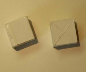 Wooden cubes covered with paper