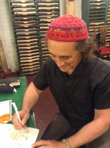 Mark Rylance writing with a quill